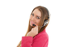 Happy business woman with headset. Happy young business woman with headset on a white background. Operator of support service Royalty Free Stock Photography