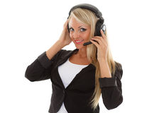 Happy business woman with headset. Happy young business woman with headset on a white background. Operator of support service Stock Photo