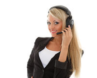 Happy business woman with headset. Happy young business woman with headset on a white background. Operator of support service Royalty Free Stock Image
