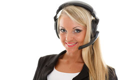 Happy business woman with headset. Happy young business woman with headset on a white background. Operator of support service Royalty Free Stock Photos