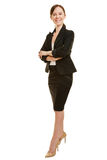 Happy business woman with her arms crossed Stock Image