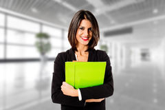 Happy business woman in her office Stock Photos