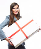 Happy Business woman hold gift box. White backgrou. Nd isolated female model Stock Image