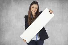 Happy business woman holding a blackboard with space for ad Stock Images