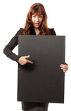Happy business woman holding a blank billboard. Portrait of a beautiful happy business woman holding a blank billboard. Ready to add text Stock Photography