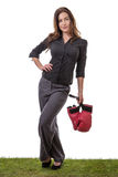 Happy business woman holding boxing gloves Stock Photo