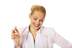 Happy business woman holding broken cigarette Stock Photo