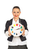 Happy business woman holding clock Stock Photos