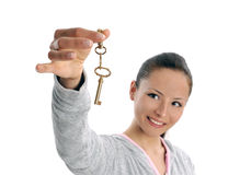 Happy business woman holding keys on white. Business woman holding keys over white background. happy young women. focus on key Royalty Free Stock Image