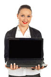 Happy business woman holding laptop Stock Images