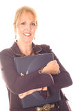 Happy business woman holding a laptop. Photo of a happy business woman holding a laptop Stock Image