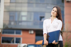 Happy business woman holding laptop. And smiling stock images
