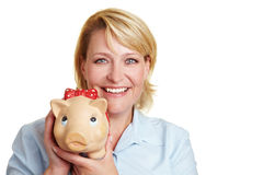 Happy business woman holding piggy Royalty Free Stock Photo