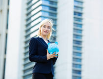 Happy business woman holding piggy bank Royalty Free Stock Photos