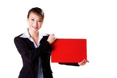 Happy business woman holding a red card. Happy smiling business executive holding a F4 size red board Stock Images