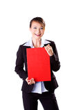 Happy business woman holding a red card. Happy smiling business executive holding a f4 size red board Royalty Free Stock Photography