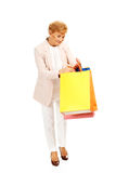 Happy business woman holding shopping bags Royalty Free Stock Image