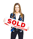 Happy Business Woman Holding Sold Sign. Isolated Studio Portrait Of A Happy And Successful Real Estate Agent Or Business Woman Holding Marketing Sold Sticker In Stock Image
