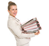 Happy business woman holding stack of folders Royalty Free Stock Image