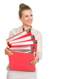 Happy business woman holding stack of folders Stock Photo