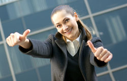 A happy business woman is holding thumbs up Stock Photo