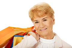 Happy business woman holging shopping bags Royalty Free Stock Photo