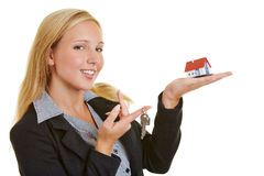 Happy business woman with house and keys Royalty Free Stock Images