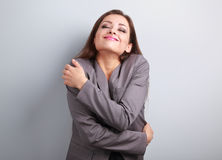 Happy business woman hugging herself with natural emotional enjo. Ying face. Love concept of yourself Stock Photo
