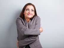 Happy business woman hugging herself with natural emotional enjo Royalty Free Stock Images