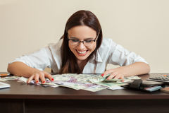 Happy business woman hugs a lot of money Stock Images