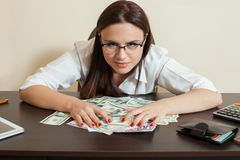 Happy business woman hugs a lot of money Royalty Free Stock Photo
