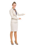Happy business woman inviting to come Royalty Free Stock Photography