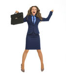 Happy business woman jumping with briefcase. Isolated on white Stock Photo