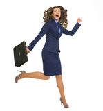 Happy business woman jumping with briefcase. Isolated on white Royalty Free Stock Photos