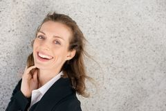 Happy business woman laughing expressing positivity. Close up portrait of a happy business woman laughing expressing positivity royalty free stock photos