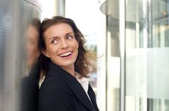 Happy business woman laughing outside Stock Photos