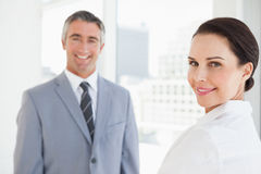 Happy business woman looking at camera. Happy business women looking at camera with co worker Royalty Free Stock Photos