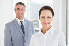 Happy business woman looking at camera. Happy business women looking at camera with co worker Stock Photos