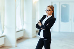 Happy business woman looking confident with modern building as b Stock Images