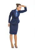 Happy business woman looking into distance Royalty Free Stock Photography
