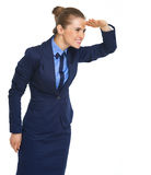 Happy business woman looking into distance Royalty Free Stock Photo