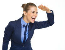 Happy business woman looking into distance Stock Photos