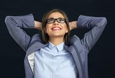 Happy business woman looking up. Black background Royalty Free Stock Images