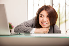 Happy business woman looking up Stock Photos