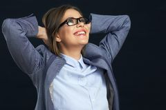 Happy business woman looking up. Black background Stock Image