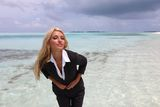 Happy business woman on the ocean coast Stock Photos