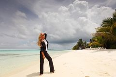 Happy business woman on the ocean coast Stock Image