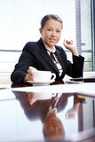 Happy business woman in the office royalty free stock image