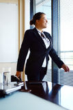 Happy business woman in the office Royalty Free Stock Images