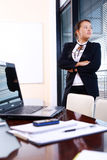 Happy business woman in the office Royalty Free Stock Photography
